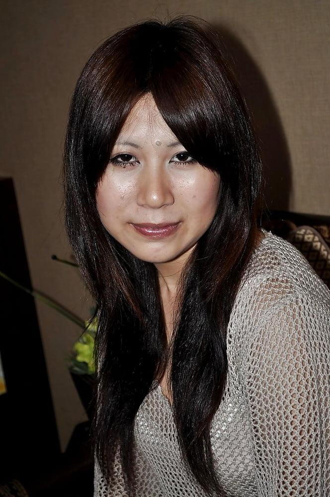 Japanese MILF Yoko stripping tan tights