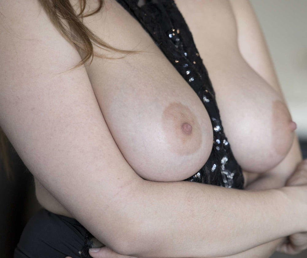 ponytailed brunette with big boobs strips